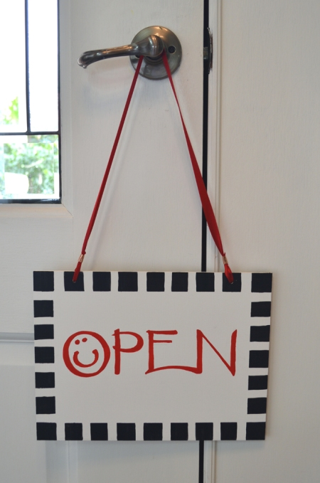 Gallery sign OPEN hanging